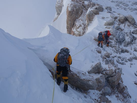 Navigating narrow ridges with steep drops marks the hair-raising route up the north side of Mount Everest for Iowa cousins Andy and John Anderson.