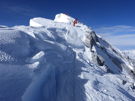 Pictured is the narrow ridge up to the summit of Mount Everest.
