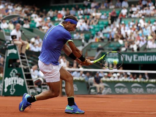 Spain's Rafael Nadal returns the ball to Georgia's