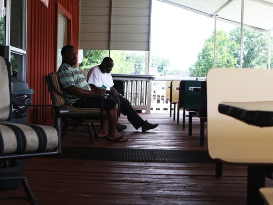 Kowalsky McNeal, left, sits with Jerry Levingston,
