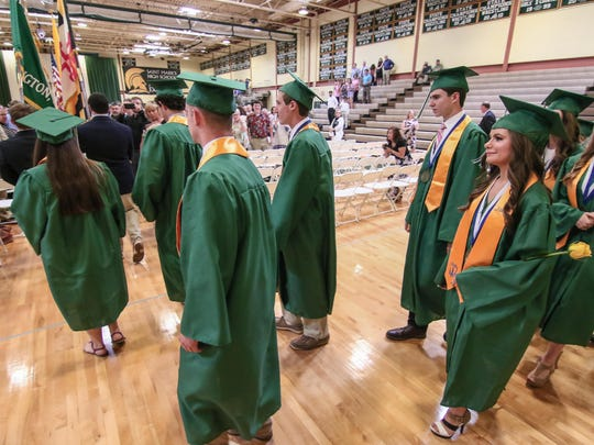 Candidates for graduation participate in the processional during St. Mark's  45th annual commencement exercise June 3. The school's enrollment has plummeted over the past decade.