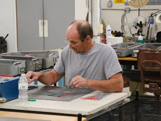 Rick Smith, of Marathon, is an operator for Sturges Electronics and is assembling wires.