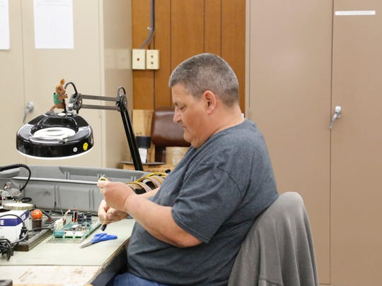 Brenda Dorsline, of Richford, is an operator for Sturges Electronics and is assembling ribbon cables.