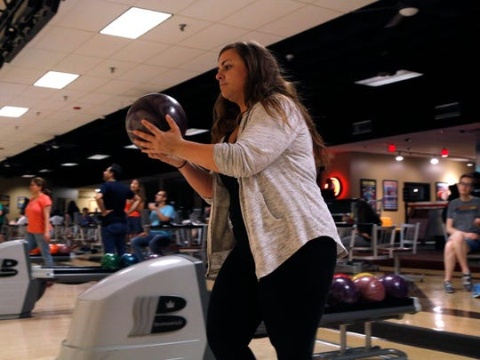 Julie Childers of Lansing bowls, Tuesday, June 13,