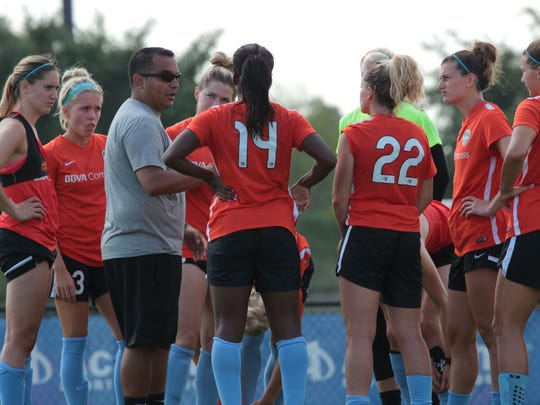 Omar Morales talks with his Houston Dash soccer players at a practice.