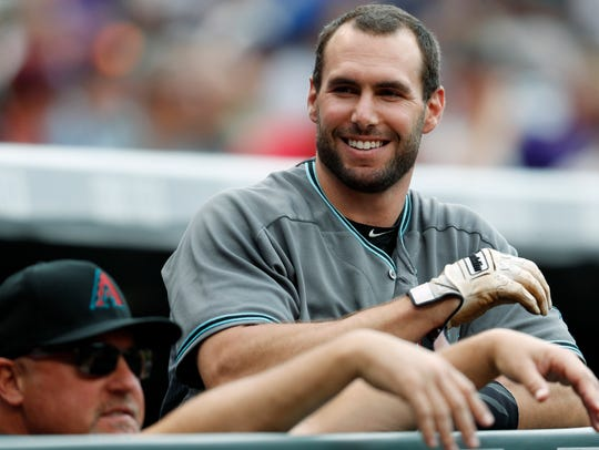 Arizona Diamondbacks' Paul Goldschmidt, right, jokes