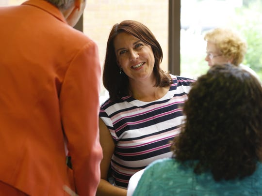 Dr. Amy Butterworth meets community members at North