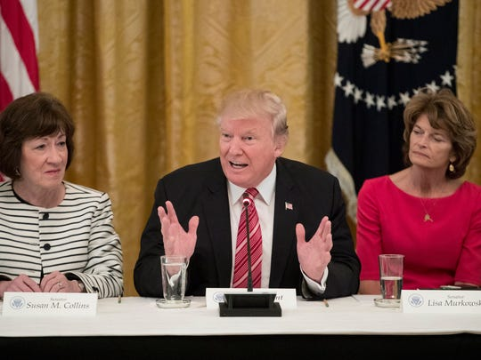 President Donald Trump delivers remarks alongside Sens. Susan Collins and Lisa Murkowski during a meeting with Senate Republicans to discuss health care legislation at the White House on June 27, 2017.