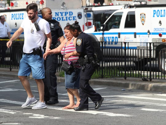 Police help people cross the street outside the Bronx
