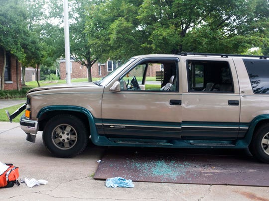 The front and driver's-side windows of an SUV were shattered in a shooting at Walter P. Taylor Homes on Saturday, July 1, 2017.