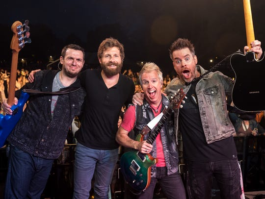 Musician David Cook and his band pose for a picture