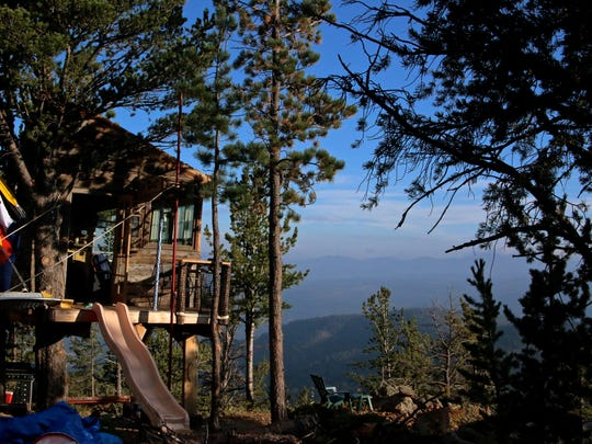 This Red Feather Lakes treehouse puts others to shame, with a slide and some Colorado pride.