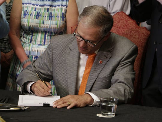 Washington Gov. Jay Inslee signs into law a measure