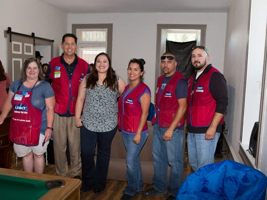 Las Cruces Boys & Girls Club Executive Director Ashley Echavarria and Lowe's team members showcase a new teen center at the club on Monday, July 10, 2018.