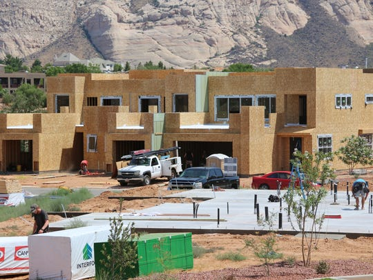 Construction crews hard at work on new housing in the