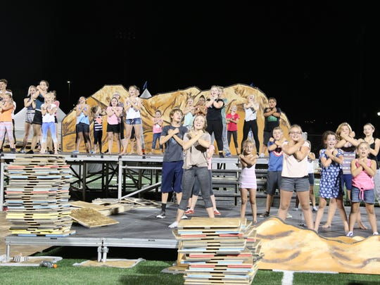 """Performers in Monday's """"Pioneer Legacy"""" festival at Dixie State University put finishing touches on the children's show Tuesday night at Legend Solar Stadium. The Merrill and Justin Osmond-produced event will pay tribute to people throughout history who have paved the way for Southern Utah's modern-day society."""