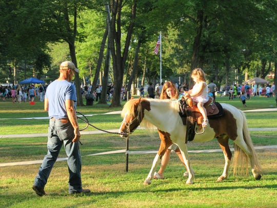 Pony rides offered at National Night Out in Middlesex