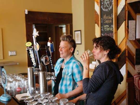 Amelia Sauter (right) drinks one of the craft beers