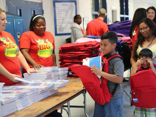 Thousands lined up to get backpacks, school supplies and haircuts at the 18th annual Big Backpack Event last year at Paul Laurence Dunbar Middle School.