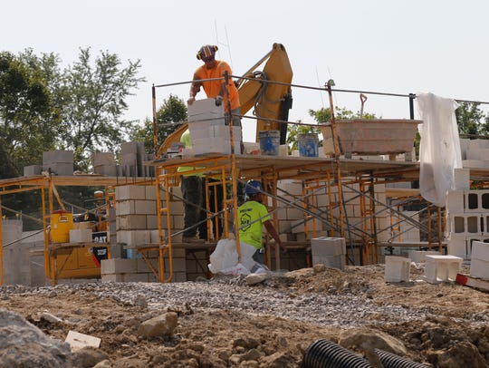 Construction personnel work on Cayuga View Senior Living.