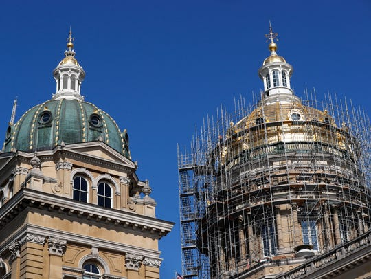 Scaffolding wraps around the dome of the Iowa Capitol