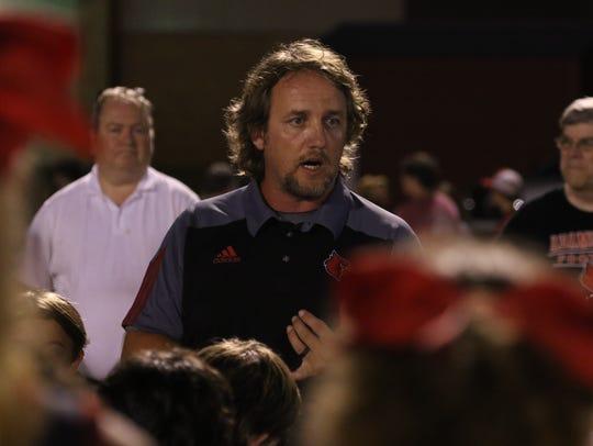 Adamsville coach Brandon Gray talks to his team after
