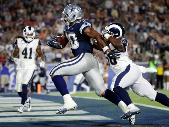 Cowboys tight end Rico Gathers scores a touchdown during