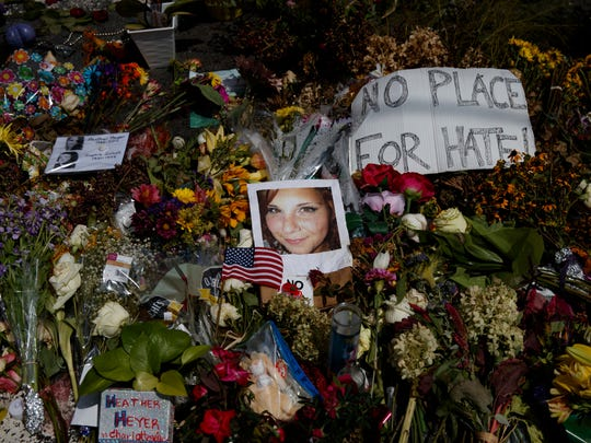 A photo of Heather Heyer, who was killed during a white nationalist rally, sits on the ground at a memorial the day her life was celebrated at the Paramount Theater, Wednesday, Aug. 16, 2017, in Charlottesville, Va. (AP Photo/Evan Vucci)