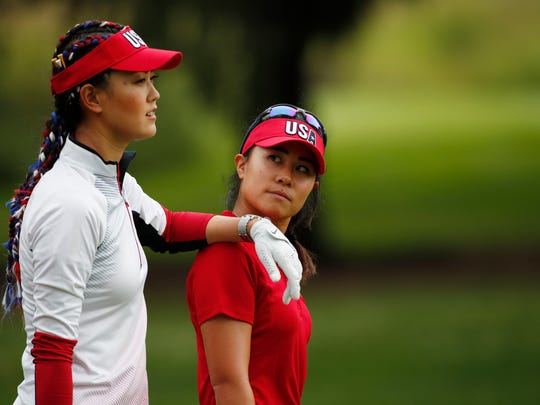 USA players  Michelle Wie and Danielle Kang walk the 4th hole together during the practice for The Solheim Cup international golf tournament  at Des Moines Golf and Country Club.