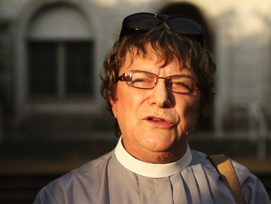 The Rev. Bette Kauffman speaks in honor of those killed