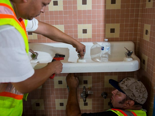 Tim Soto (left) and Daniel Wills, plumbers with the