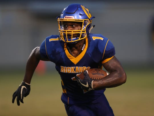 Rickards' Destin Coates runs with the ball against