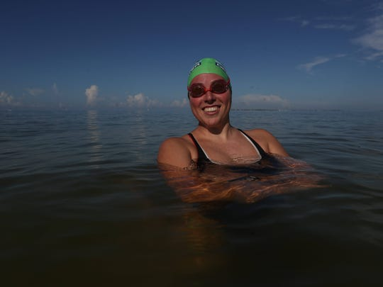 Fort Myers High graduate Heather Roka trains in the Gulf of Mexico off of Fort Myers Beach on Thursday morning. She is making an attempt to cross the English Channel in the next week or so. Her window of oppotunity is August 21-28.
