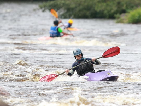 Kayaker competes during Sunday's Midwest Freestyle Championships at the Wausau Whitewater Park in downtown Wausau.