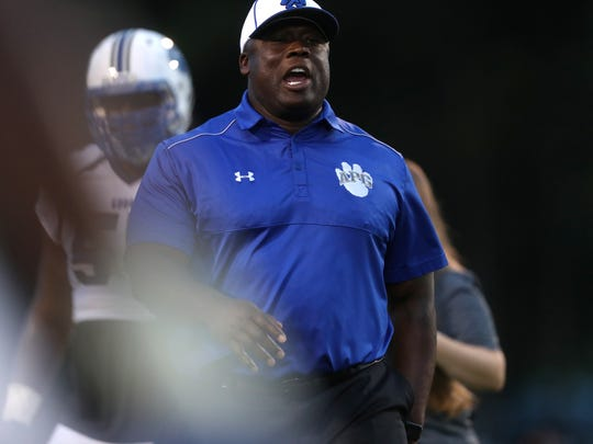 Godby Coach Corey Fuller yells out to his team during