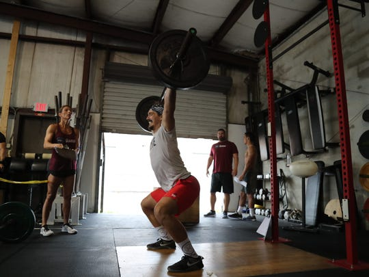 Local crossfit athletes participate in the SWFL Sharks Athlete Combine at Crossfit Cape Coral on Saturday.