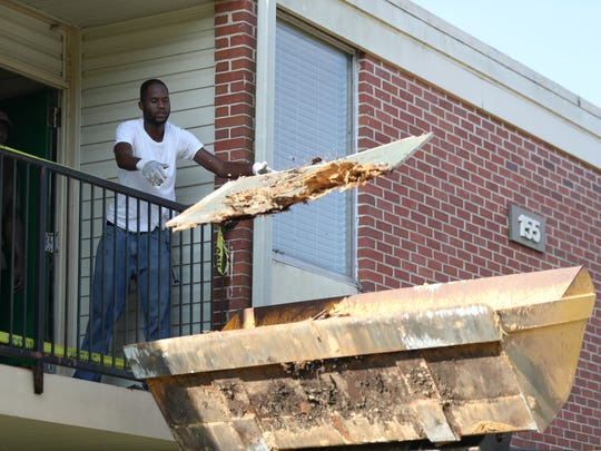 Construction crews work to repair FAMU's Palmetto North student housing as incoming students arrived to rooms that had mold and mildew, safety issues with doors and left-behind construction debris.