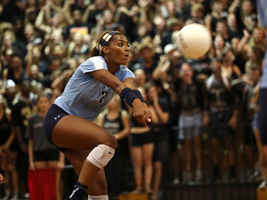 Maclay's Jewel Strawberry sets the ball against Chiles