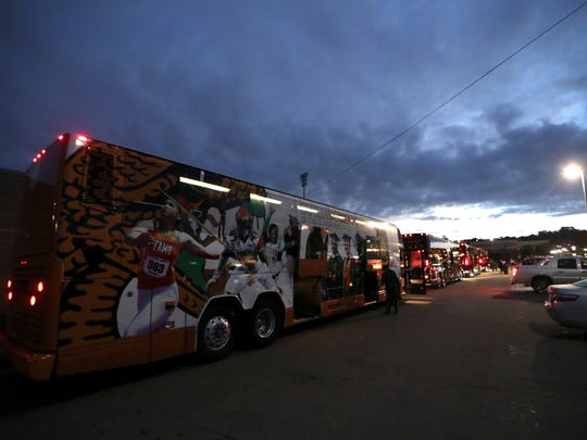 The FAMU football team boards four buses early Wednesday