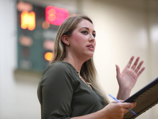 Lincoln Head Coach Katie Johnson leads her team against
