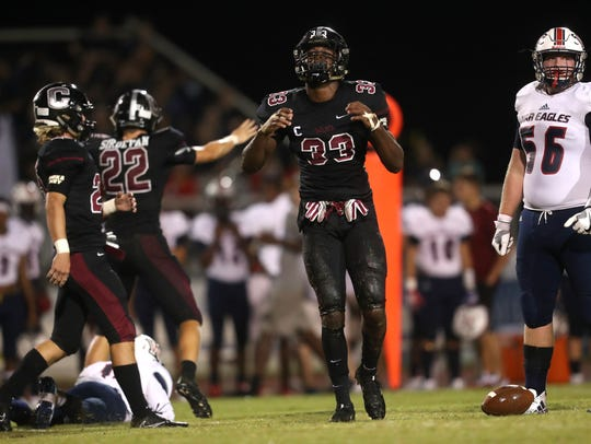 Chiles' Amari Gainer celebrates breaking up a pass