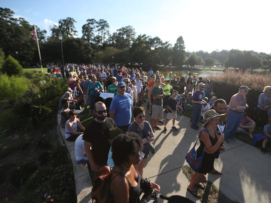 Hundreds of people gathered at Lake Ella for a vigil
