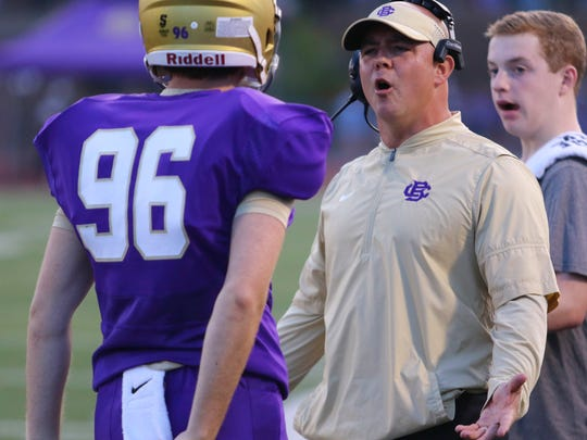 CBHS head  coach Thomas McDaniel has a question for Lohn Lutz as he comes off the field against White Station on Friday, Sept. 1, 2017.