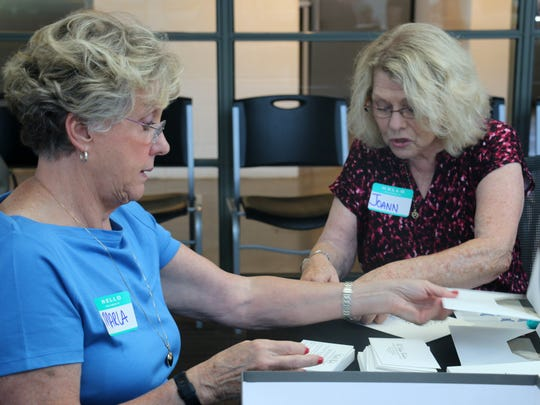 Joann Tallman, 74, and Marla Thompson, 69, volunteer to prepare all the Heritage Ball invites before the organization mails them to attendees.