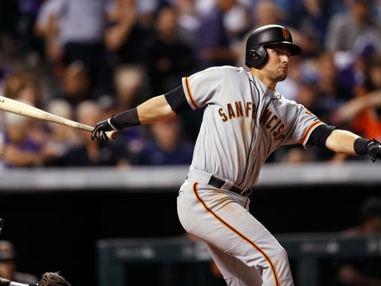 San Francisco Giants' Joe Panik watches his RBI double off Colorado Rockies starting pitcher Jeff Hoffman in this file photo from the past season.