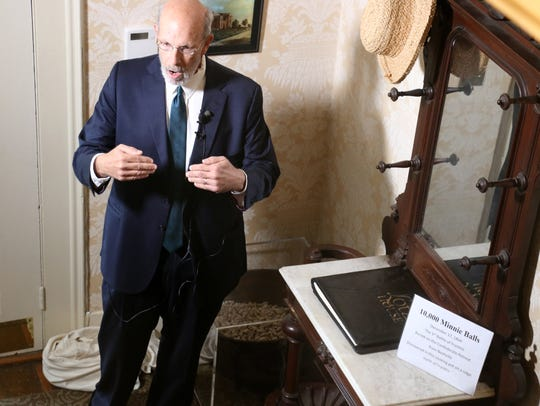 Lotz House historian Thomas Cartwright unveils 10,000 Minie balls on display at the Lotz House.