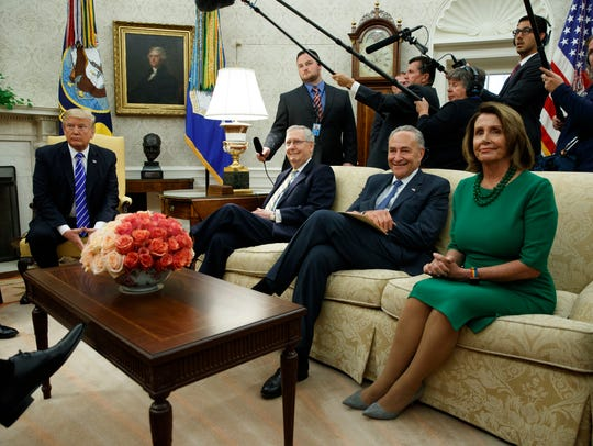 President Trump is pictured with Senate Majority Leader