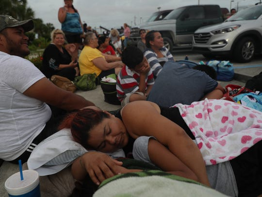 Florida residents wait to enter Ray V. Pottorf Elementary