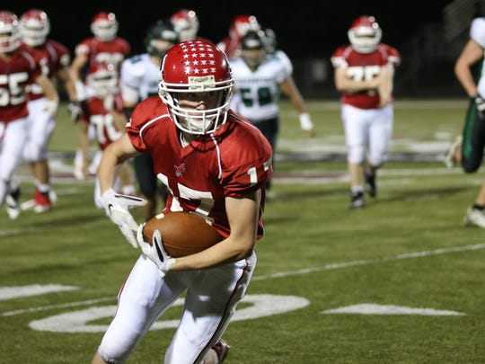 Pacelli's Nate Helms looks for extra yardage after hauling in a pass in the fourth quarter of the Cardinals' 22-20 loss to Wittenberg-Birnamwood on Friday night.
