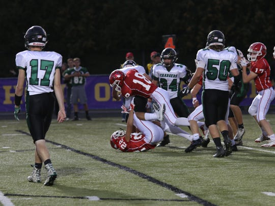 Pacelli's Richard Zupan (22) and Isaac Pisarski combine on a tackle in a Central Wisconsin Conference-8 matchup with Wittenberg-Birnamwood on Friday night.